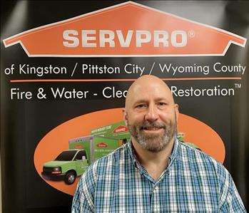 Male SERVPRO marketer in front of pop up sign